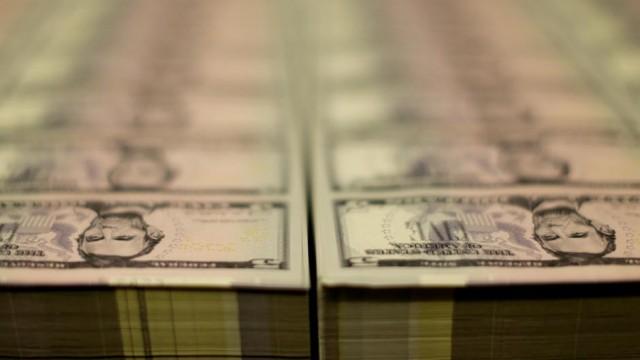 Dollar firms as Fed members talk of tightening