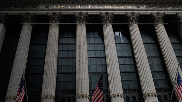 Nasdaq, S&P 500 end at records, Dow drops as investors await Fed